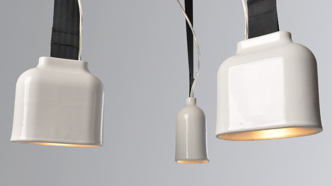 Hardy's new Bell pendant, a ceramic light suspended by a seatbelt strap