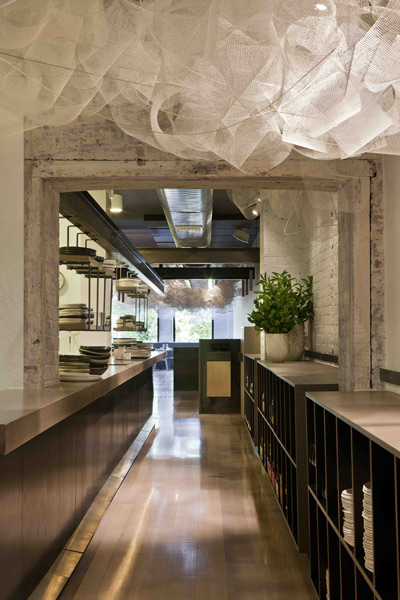 The kitchen at Tonka is positioned in the centre of the long, narrow tenancy – a mediator between the bar and dining zones