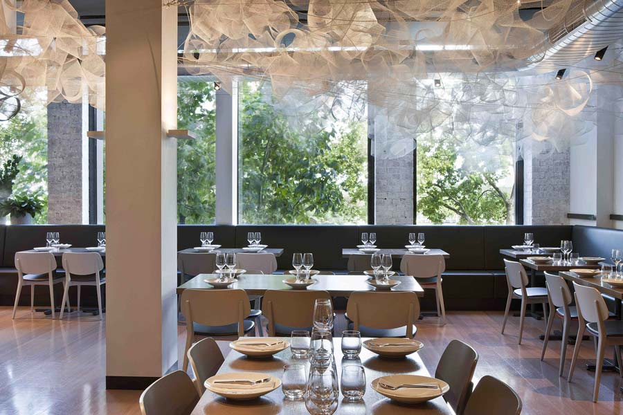 Located at the far end of the tenancy, the Tonka dining room takes full advantage of the building's windows
