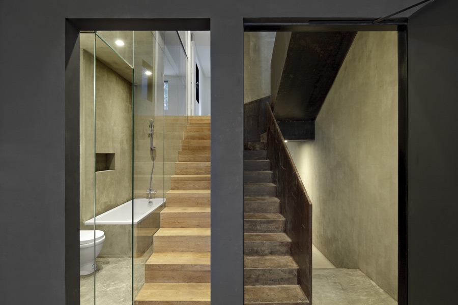 Dual access stair with contrasting timber finish