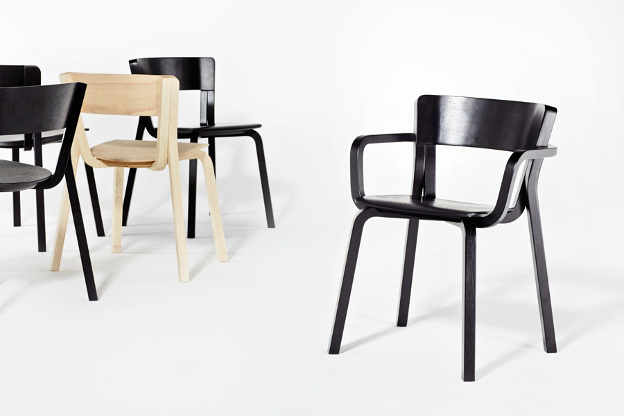 The Para armchair and stacking chair, made from moulded rubberwood ply and designed by Adam Goodrum
