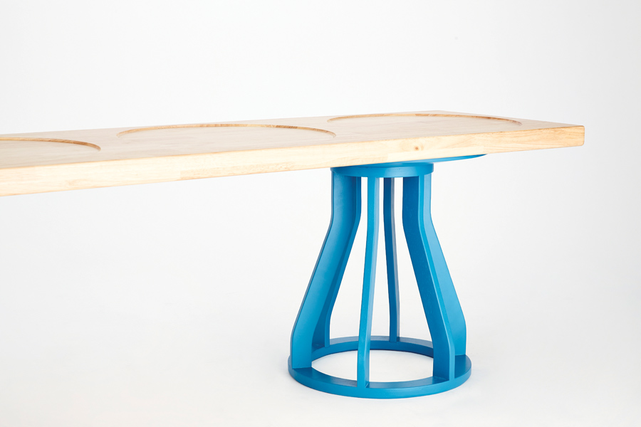 An extension of the Spool stool, Goulder's Plank bench features a solid rubberwood bench atop two stools