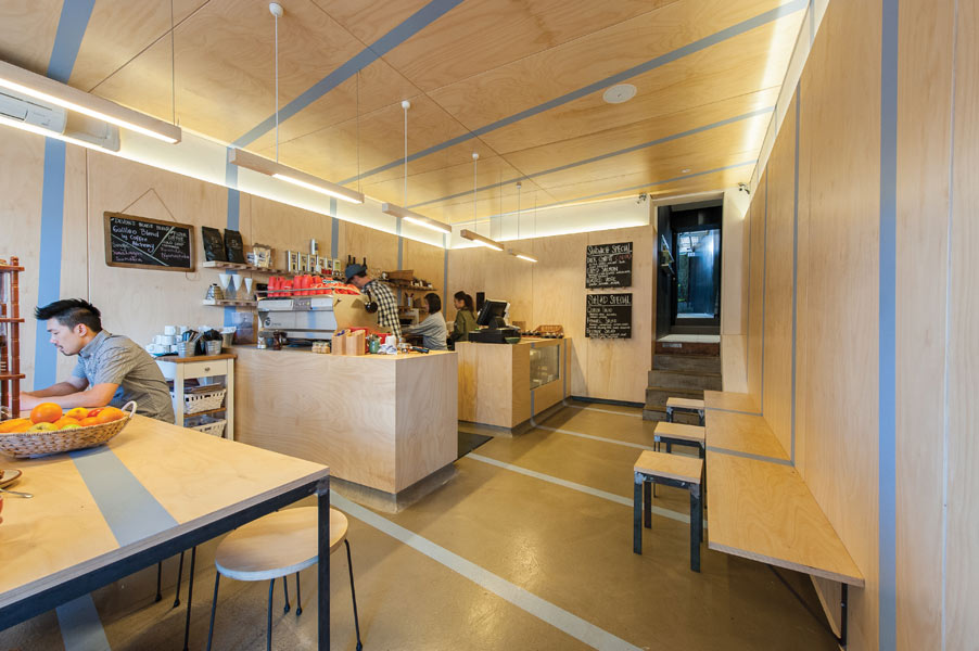 The plywood- wrapped interior of Devon Cafe in Surry Hills, by Matt Woods Design