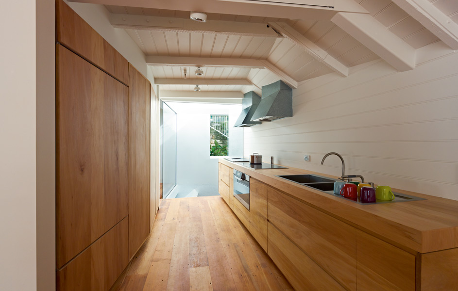 Kitchen area is hidden from view and overlooks the main stair