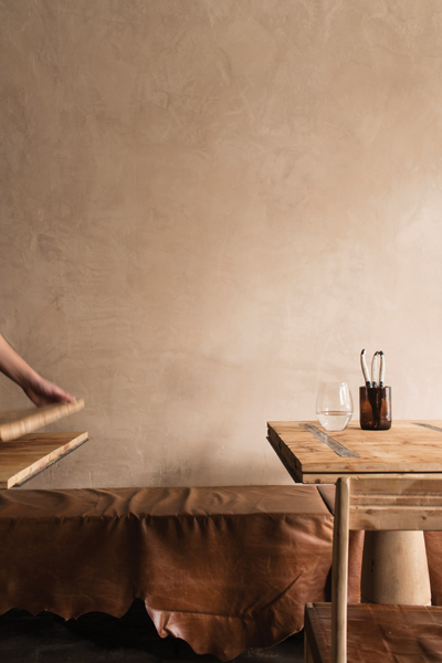 Hinged sections in the communal dining table at Farmhouse allow easy access within the small space
