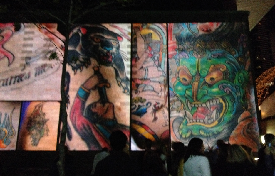 A collage of tattoo art projected on the facade of the National Gallery of Victoria