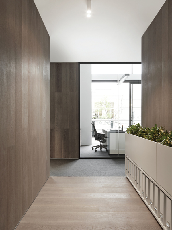 Walls have been clad in an engineered timber board from Pacific Floors to add softness to the area