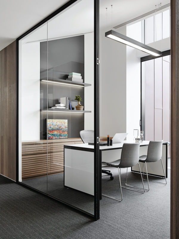 Executive offices are spacious and feature custom- made desks and Catifa chairs from Stylecraft