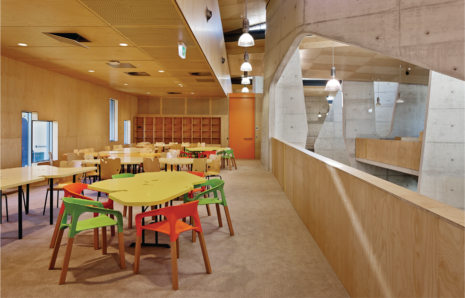 Open plan teaching spaces are spliced between the 'scoops'