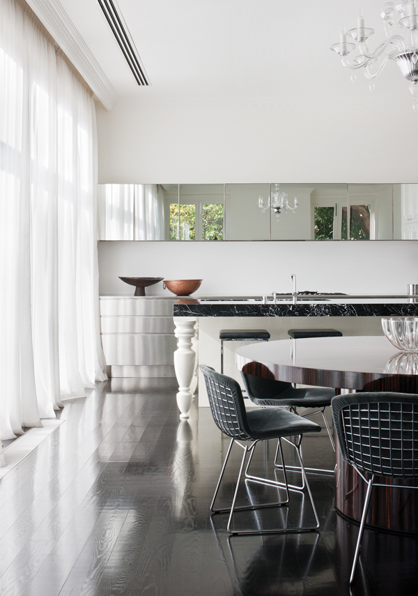 Custom dining table made of Macassar Ebony with Bertoia polished chrome chairs from Knoll