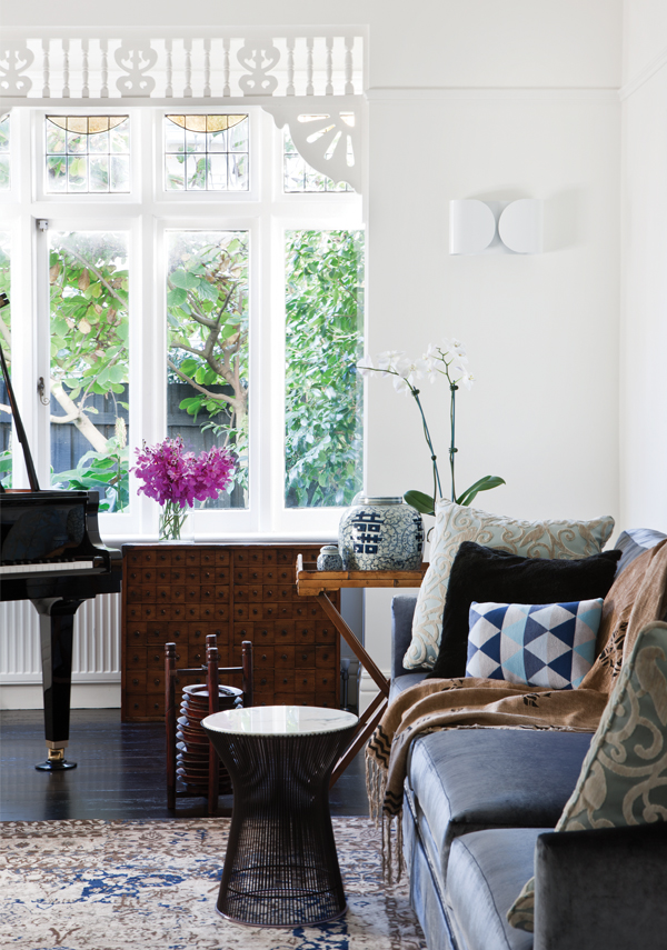 The front sitting room in the original section of the house is the perfect setting for the client's own baby grand piano, bespoke and vintage furniture pieces
