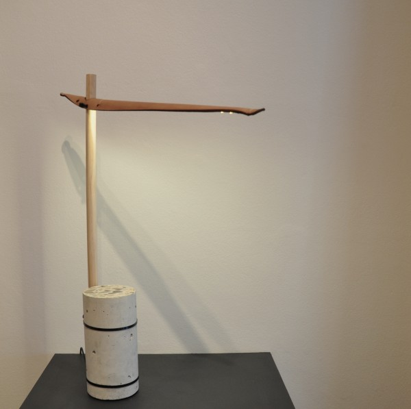 Lamp, made from timber, concrete, cable ties and leather; design by Garðar Eyjólfsson. Photograph: Charles Rowe