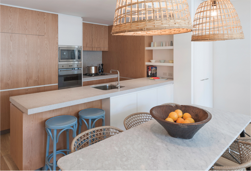 Erko in Erskineville, timber laminate cabinetry, timber floors and natural stone surfaces. Photo: Mark Syke