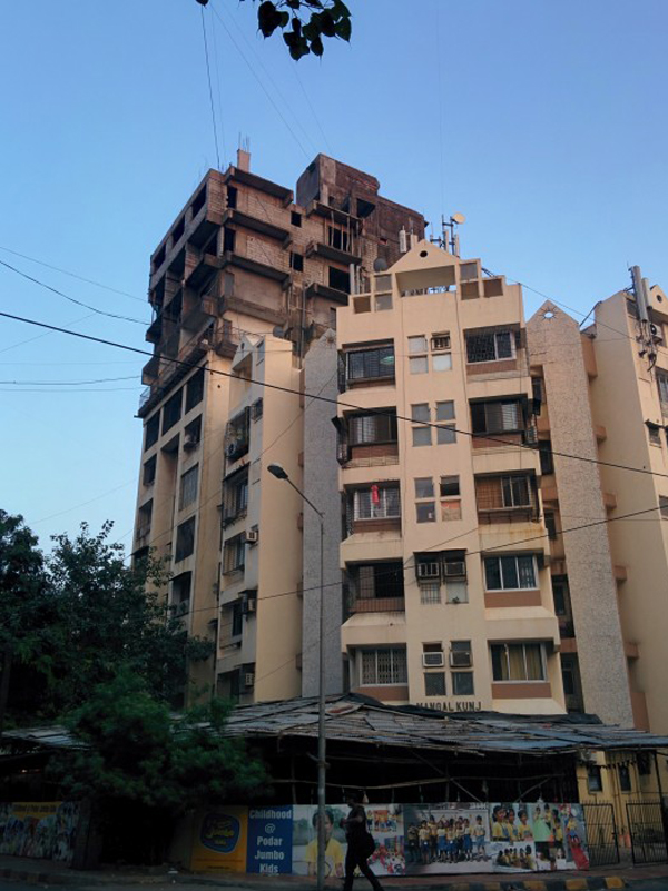 Mangal Kunj residentail building after the construction of the upper floors. Bandra (W) – Mumbai, India. Image © Laura Amaya
