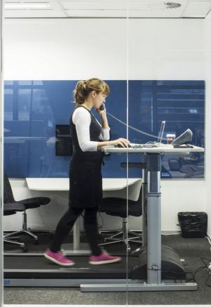 SMH journalist Amanda Hooton using the treadmill desk. Photo: Nic Walker