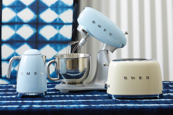 Smeg kettle, mixer and toaster in pale blue and pana cotta cream