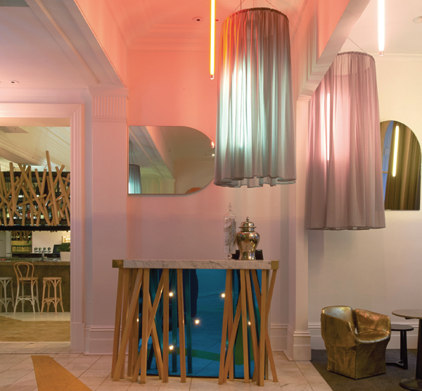 Vertical neon lamps by Mance Design are softened by skirts of debutant shades while a yellow zigzag is allowed the wear of traffic.