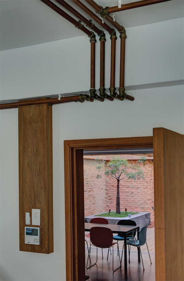 Brass pipe detail is a feature and of the design and is found throughout the apartment.