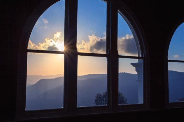Arched windows frame the magnificent view.