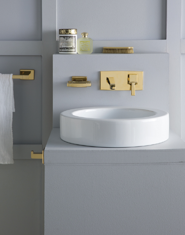 Metallic finishes are on trend and Astra Walker has used a gold finish to complement this bathroom.