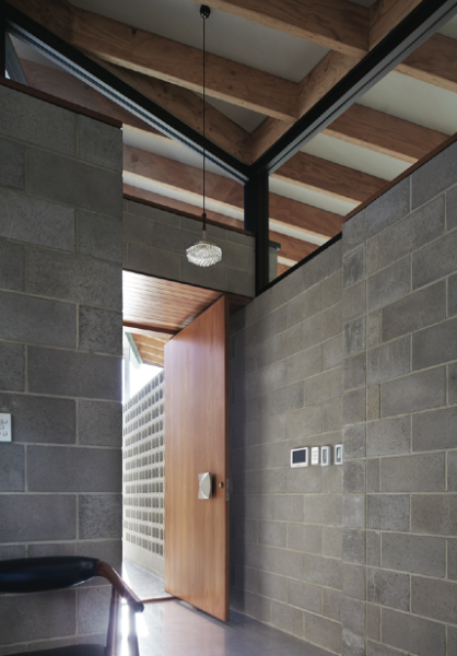 In the Concrete House by Fringe Architects, the concrete and breezeblock entry is a tribute to Iwanoff, photo by Robert Firth.