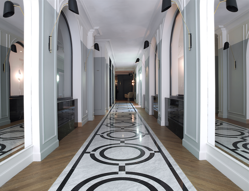 The grand entrance hallway with inlaid Carrara marble motif.