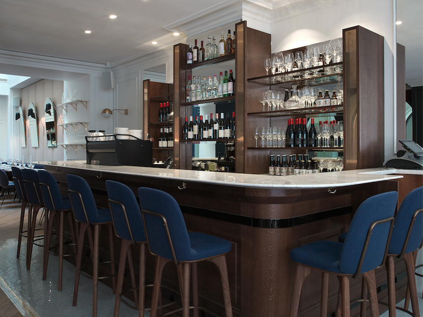 The bar in the front of the main dining area services the restaurant.