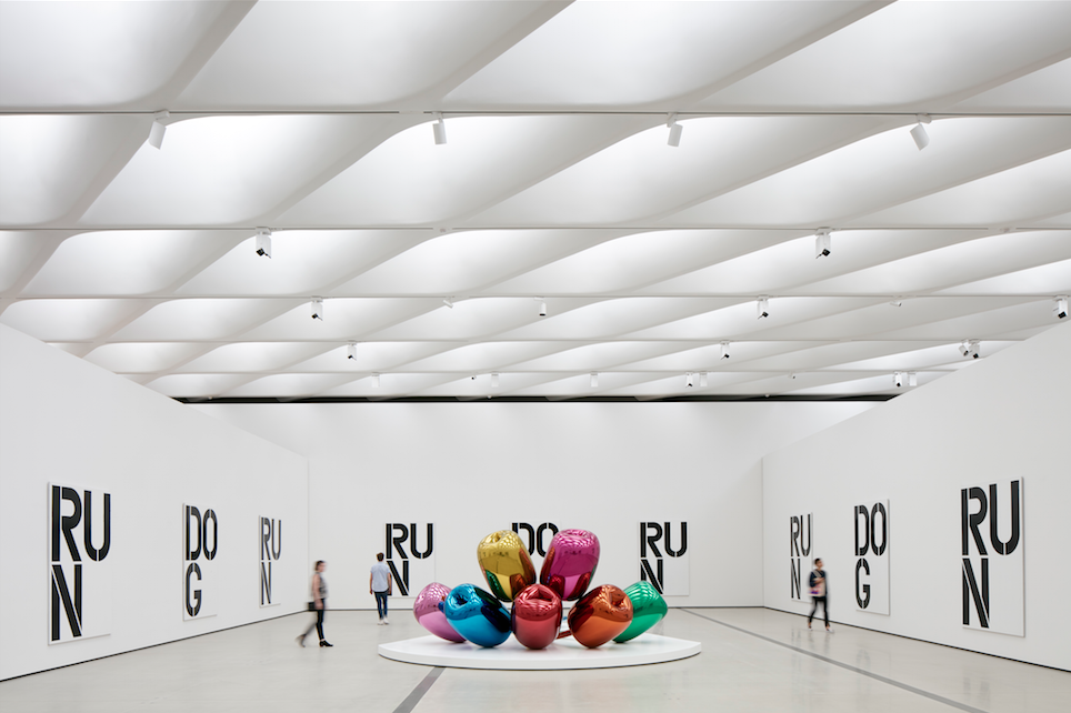"""Christopher Wool's black and white """"Untitled"""" work of 1990, along with Jeff Koons' """"Tulips"""" (1995-2004)."""