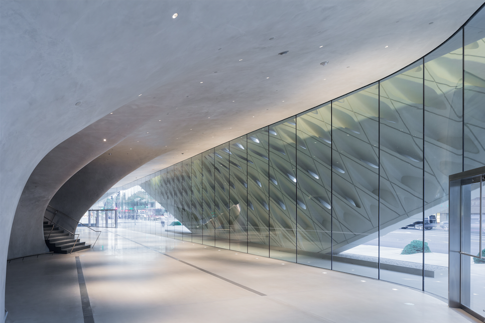The curves of the museum's lobby transitions visitors from from LA's sun drenched expanse to a cosseted and cool interior.