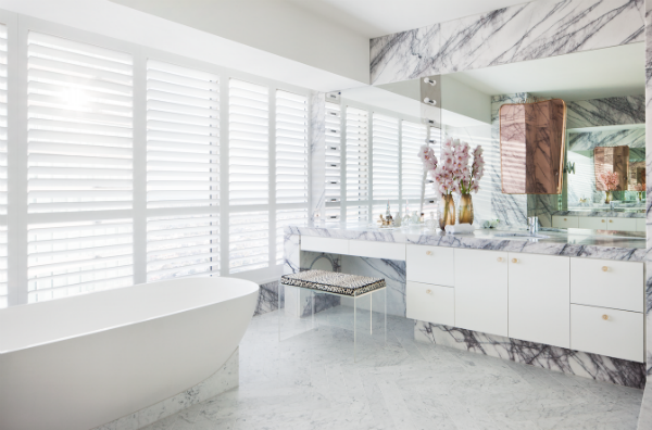 Materiality is continued throughout the apartment with the use of mirror and marble.