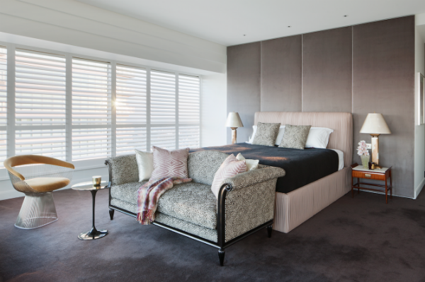The luxurious bedroom with ruched leather bed surround that echoes the detail of the living room sofa.