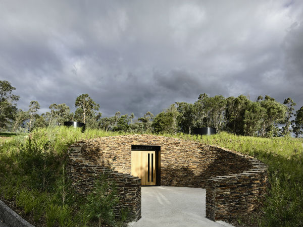 The enveloping forecourt situates visitors within the Estate.